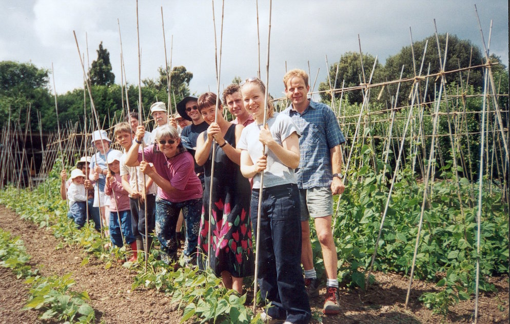 Stroud Community Agriculture members with bean sticks