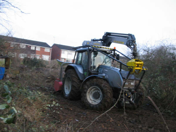 Tractor clearing growth
